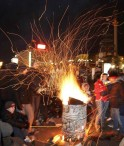 Protesters supporting EU integration warm themselves around a fire near a barricade at Independence Square in Kiev