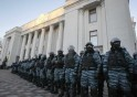 Police stand guard in front of the Parliament building during a demonstration in support of EU integration in Kiev