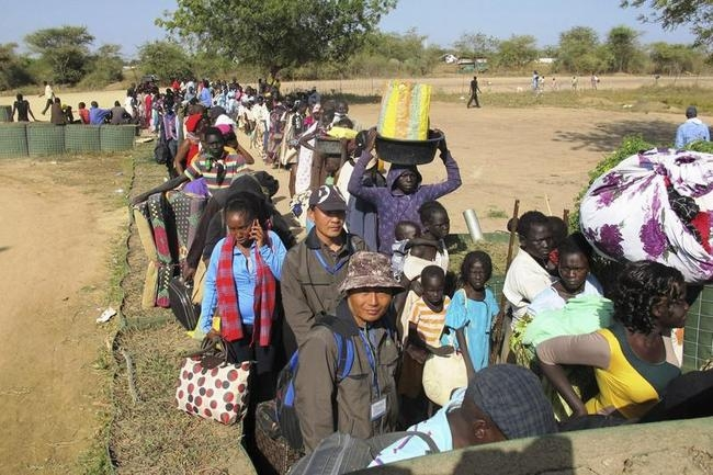 Civilians arrive for shelter at the United Nations Mission in the Republic of South Sudan (UNMISS) compound in Bor, South Sudan