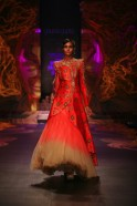 "Creating an ultra-luminescent collection of bridal wear at the Aamby Valley India Bridal Fashion Week 2013, Gaurav Gupta proved that his collection ""Lightfall 2013"" was an Avant Garde offering to the fastidious bride."