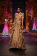 Gold embroidery snaked down from the necklines of moulded ensembles, while the lehenga/gowns with attached dupattas will create a glamorous trend. Bringing in layered net voluminous skirts with double breasted net covers some with extended shoulders, Gaur