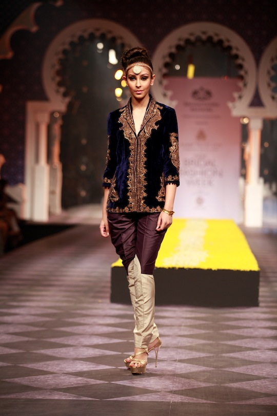 Striking sherwanis in a shorter version with zari work and combined with slim pants. Women's wear drew its influence from traditional shapes across Asia and presented a refined style of dressing with a hint of decadent touches.