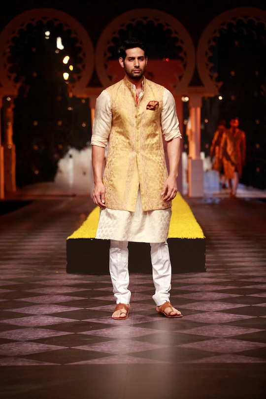 Jackets with gold trims, sherwanis richly embellished with intricate embroidery and the three piece Bandgala/kurta/sherwani trio in black brocade was a stately offering.