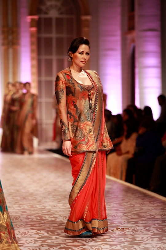 "Creating melodious fashion on the ramp at Day Four at the fifth Aamby Valley India Bridal Fashion Week 2013, designers Ashima Leena presented their ""Aalap"" bridal collection that recreated the grandeur of the Mughal era and days gone by. Inspired by"