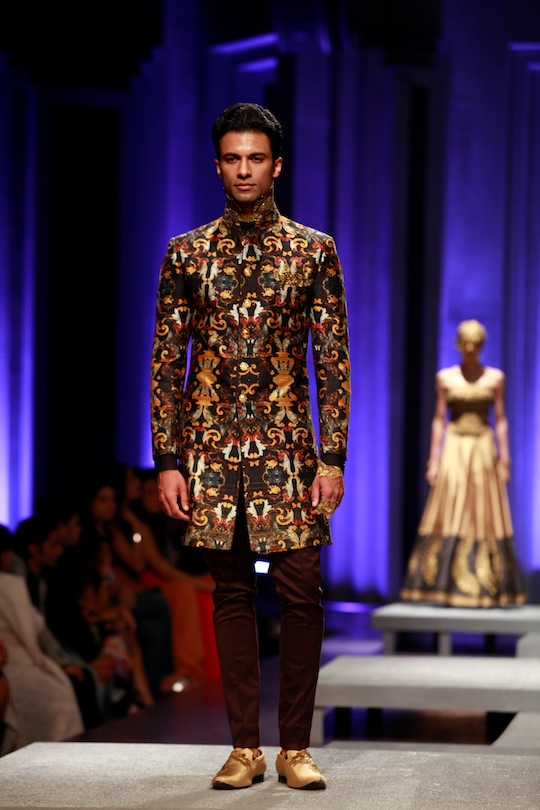 Men's wear was stylish with heavily embellished Jodhpuri jackets, sherwanis teamed with dhoti pants and some innovatively draped kurtas with gold embroidered shoulders.