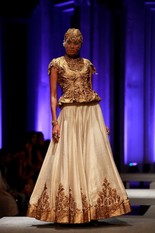 From the mini flared peplum tops with embroidered yoke to white embellished sheath gowns, panelled kurta with dusty gold 3D shoulder interest, trapeze brocade jacket with high pleated neck and the gold peplum blouse with shoulder appliques, the show was s