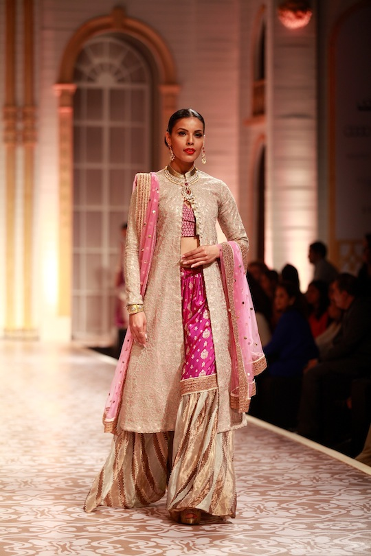 A tiny silver shrug over a traditional kurta was a trendy addition, while boleros with intricate work appeared over tunics. Shades of wine and shocking pink georgette with gold tissue gave a bridal look to the lehengas in the show.