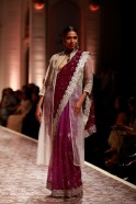 Shades of purple georgette, chiffon and net for saris which were worn with white chikankari capes were stately in style and design. Angarkhas were panelled, while shararas with tissue stripes created an innovative touch.
