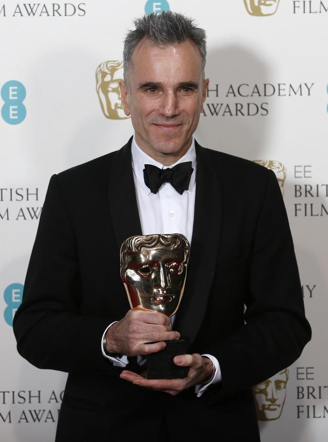 "Daniel Day-Lewis celebrates after winning the Best Actor award for ""Lincoln"" at the British Academy of Film and Arts (BAFTA) awards ceremony in London"