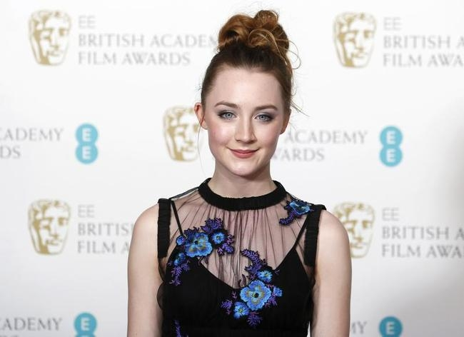 Saoirse Ronan poses for photographers at the British Academy of Film and Arts (BAFTA) awards ceremony in London