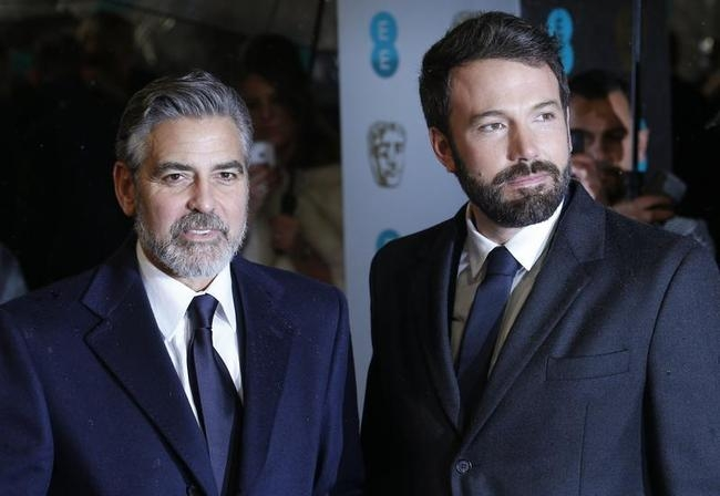 George Clooney and Ben Affleck pose as they arrive for the British Academy of Film and Arts (BAFTA) awards ceremony at the Royal Opera House in London