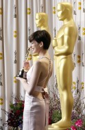 "Anne Hathaway holds her Oscar for Best Supporting Actress for her role in ""Les Miserables"" at the 85th Academy Awards in Hollywood"