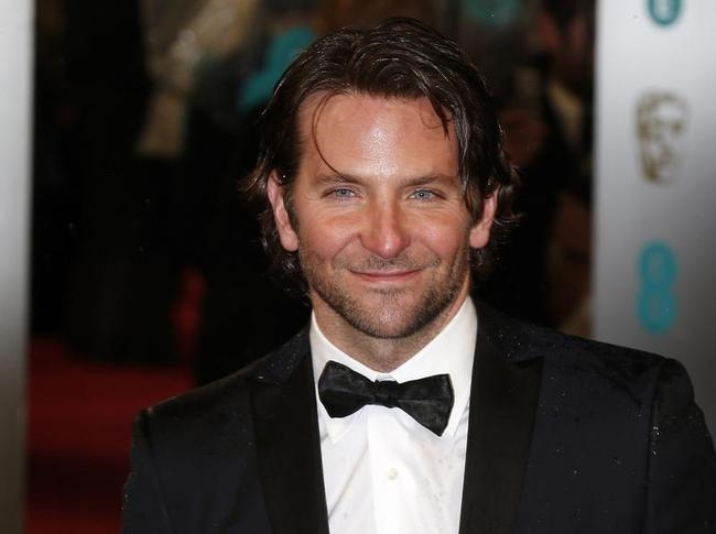 Bradley Cooper poses as he arrives for the British Academy of Film and Arts (BAFTA) awards ceremony at the Royal Opera House in London