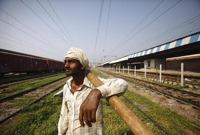 A worker is pictured at the newly built track in Allahabad