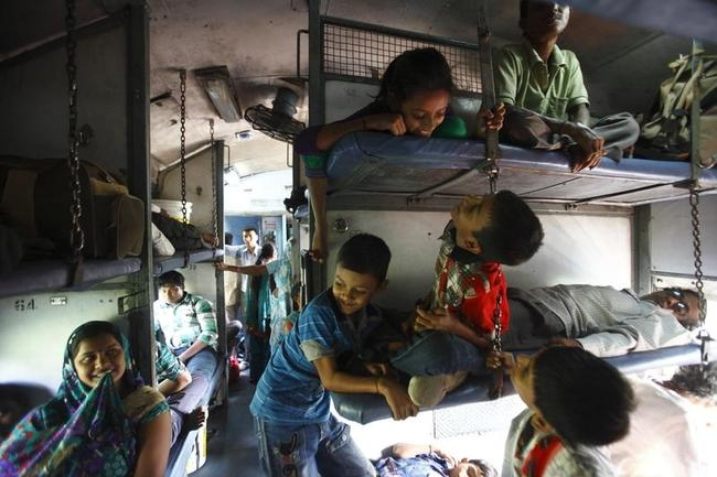 Children travel on a train heading from Agra to Kanpur in Uttar Pradesh
