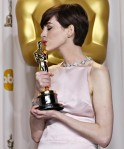 "Anne Hathaway, best supporting actress winner for her role in ""Les Miserables"", poses with her Oscar at the 85th Academy Awards in Hollywood"