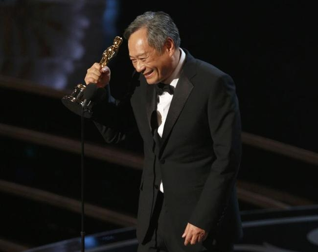 "Director Ang Lee reacts after winning the Oscar for best director for ""Life of Pi"" at the 85th Academy Awards in Hollywood"
