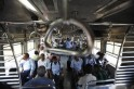 Commuters travel by suburban train as they head toward their destination in Mumbai