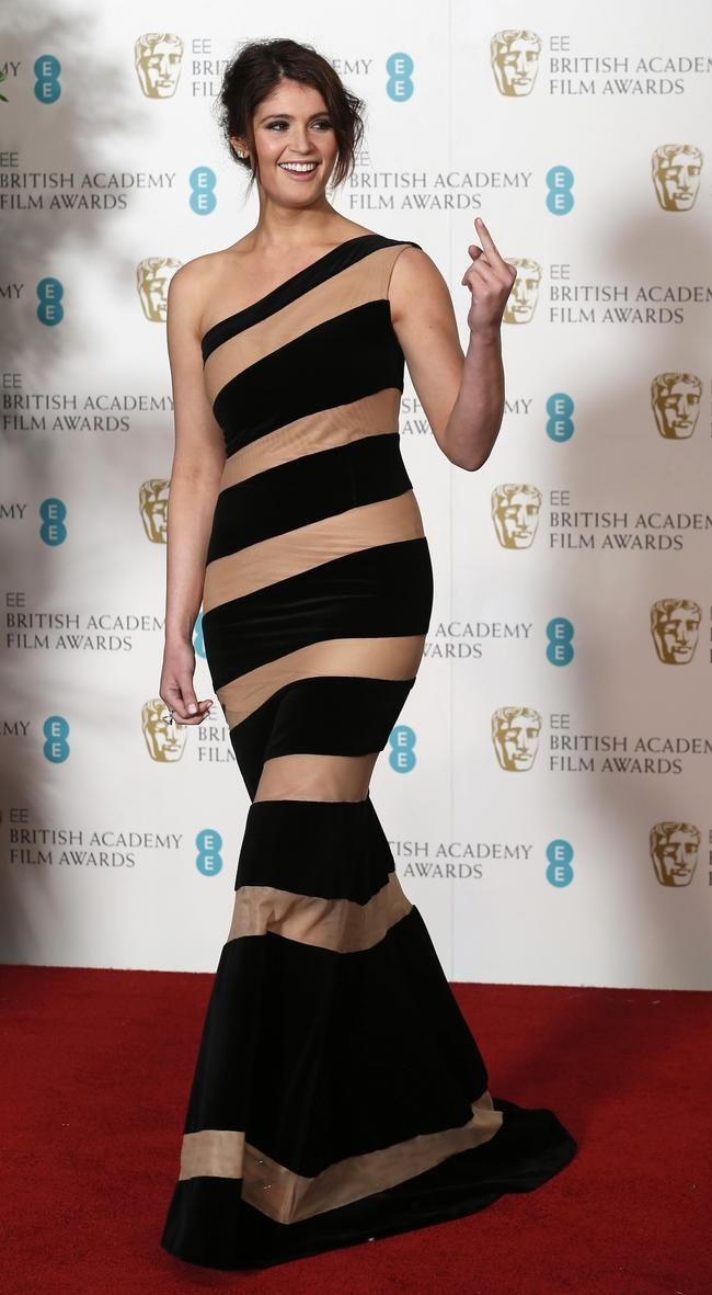 Gemma Arterton gestures after posing for photographers at the British Academy of Film and Arts (BAFTA) awards ceremony in London