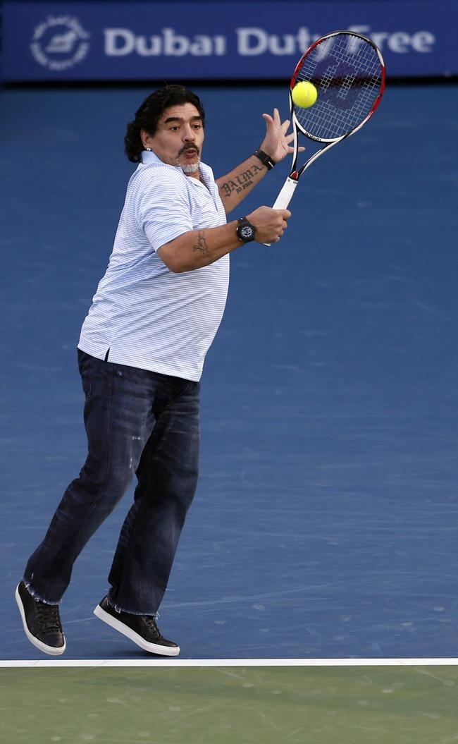 Diego Maradona Plays Tennis