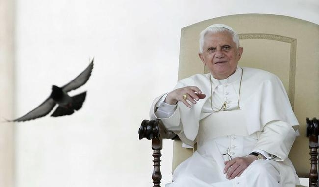 File photo of Pope Benedict XVI waving to the faithful during his weekly general audience in Saint Peter