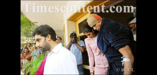 Amitabh Bachchan (blue) is escorted by his daughter Shweta Nanda and son Abhishek Bachchan (left) to the Nanavati Hospital, after he complained of severe abdominal pain on his 66th birthday, in Mumbai on October 11, 2008.