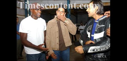 Carl lewis (left), with film stars Abhishek Bachchan(centre) and John Abraham(right) at the Music shoot of Dhoom at Mumbai on July 24, 2004.