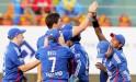 England bowler Steven Finn celebrates with teammates after dismissing Indian batsman A. Rahane