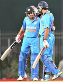 Virat Kohli being greeted by Yuvraj Singh on completing his half century during the 3rd ODI cricket match against England