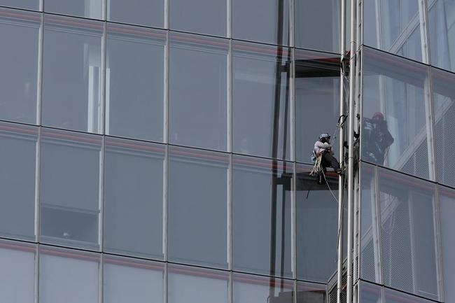 Greenpeace demonstrators climb the Shard building, in central London