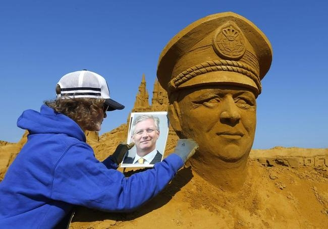 Sand sculptor Natalia Botalova works on a portrait of Belgian Crown Prince Philippe during the Sand Sculpture Festival in Blankenberge