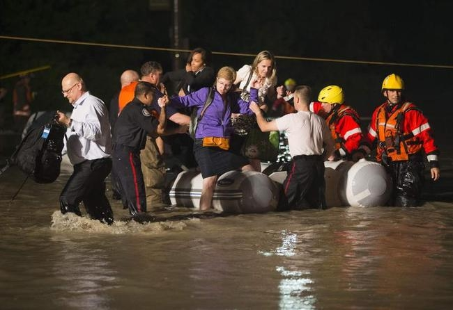 Dingy full of passengers that were stranded on Go Train are rescued during a heavy rainstorm in Toronto