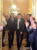 Tennis player Andy Murray is applauded by government staff as he is escorted by Britain