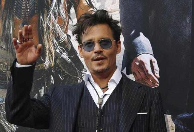 """Cast member Johnny Depp waves at the world premiere of """"The Lone Ranger"""" in Anaheim"""