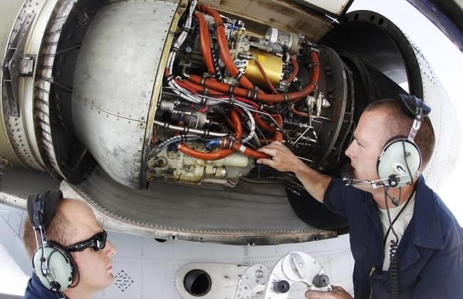 U.S. Air Force ground staff members maintain an A-10 Thunderbolt II fighter-jet at Kandahar Air Field
