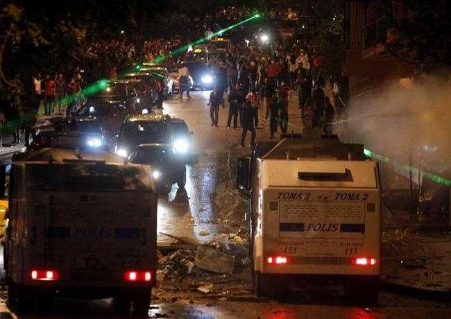 Riot police fire water cannons towards protesters during clashes at Kennedy Street in central Ankara