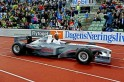 Usain Bolt of Jamaica arrives in an electric Formula 1 car during the IAAF Diamond League athletics competition at the Bislett Stadium in Oslo