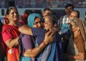 A pilgrim who was stranded in Uttarakhand reacts after meeting her relative at a railway station in Ahmedabad