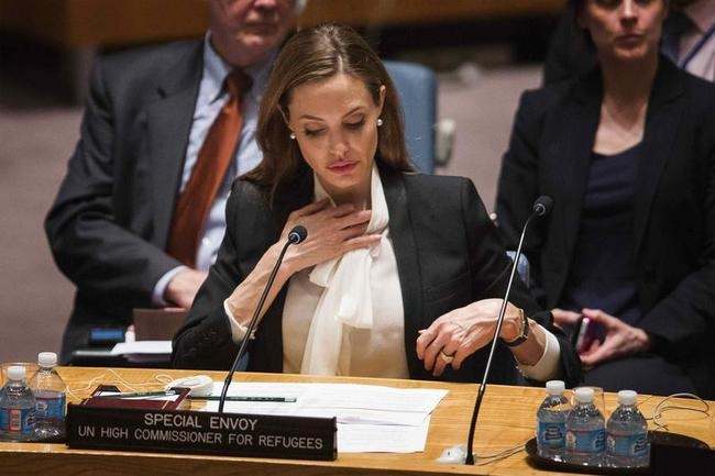 UNHCR special envoy, actress Jolie, listens during United Nations Security Council meeting in New York