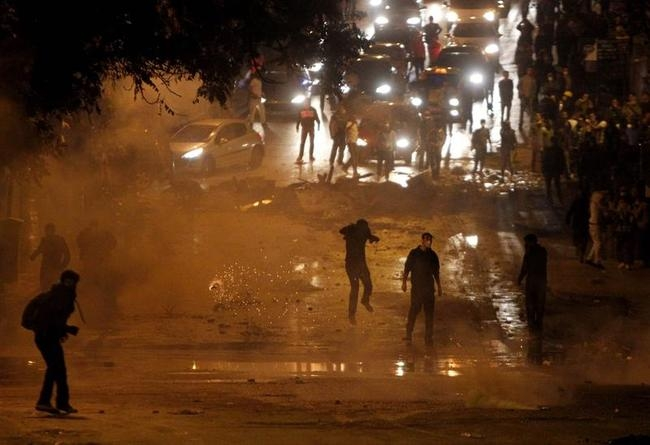 Tear gas is fired towards protesters by riot police during clashes at Kennedy Street in central Ankara