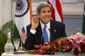 U.S. Secretary of State Kerry smiles as he asks reporter to repeat question during news conference in New Delhi