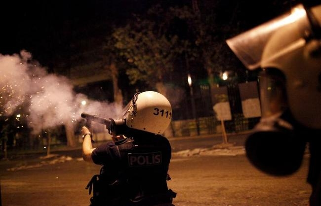 Riot police fires tear gas towards protesters during clashes in Kennedy street in central Ankara