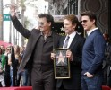 Actor Johnny Depp and Robert Iger, chairman and CEO of The Walt Disney Co. pose with film and television producer Jerry Bruckheimer during ceremonies honoring Bruckheimer with a star on the Hollywood Walk of Fame in Hollywood