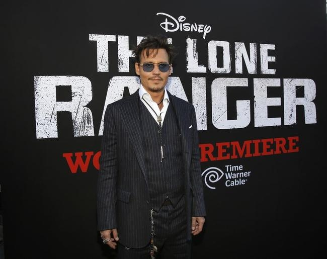 """Cast member Depp poses at the world premiere of """"The Lone Ranger"""" in Anaheim"""