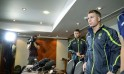 Australian cricket captain Michael Clarke and David Warner leave a press conference in London