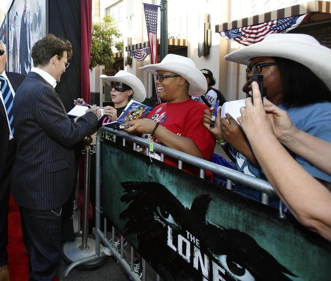 """Cast member Depp signs autographs at the world premiere of """"The Lone Ranger"""" in Anaheim"""