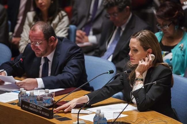 UNHCR special envoy, Jolie, listens during United Nations Security Council meeting at United Nations Headquarters in New York