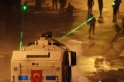 Riot police fire a water cannon at protesters during clashes in Kennedy Street in central Ankara