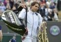 Rafael Nadal of Spain walks off the court after being defeated by Steve Darcis of Belgium in their men