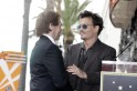 Actor Johnny Depp greets film and television producer Jerry Bruckheimer during ceremonies honoring Bruckheimer with a star on the Hollywood Walk of Fame